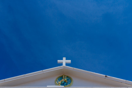 big white cross on blue sky photo
