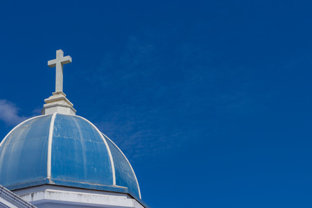 big white cross on blue sky photo