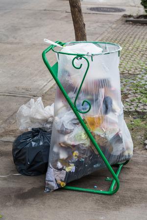 scrapheap: Garbage bags on the sidewalk dirty background