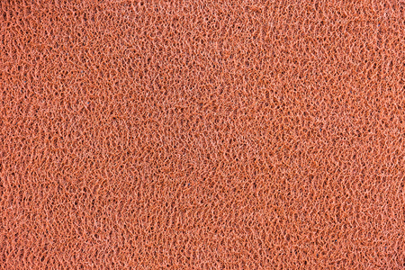 Red vinyl dust trap carpet texture background photo
