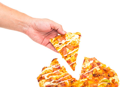 Hand Grabbing a slice of pizza isolated on white background photo