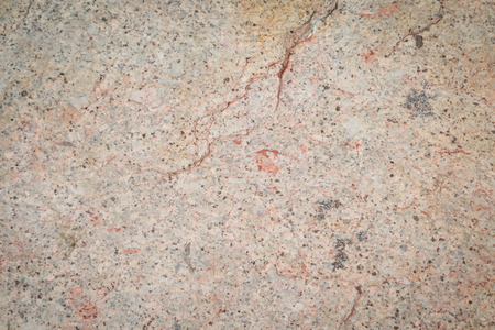 Aged Seamless stone rock texture background closeup photo