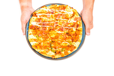 Two hand send the  Delicious italian pizza over white to you photo
