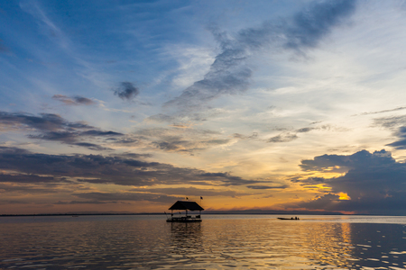 Floating house on the embankment with Sunset Background photo