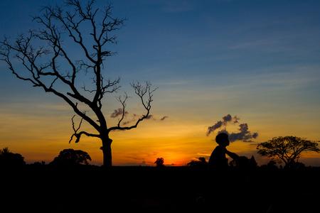 off road biking: mountainbike silhouette in sunset sky background Stock Photo