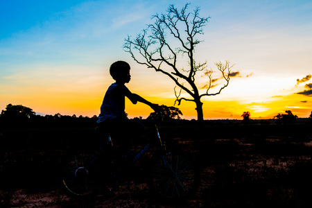 mountainbike silhouette in sunset sky background photo