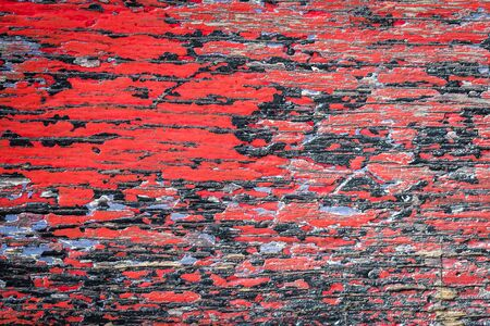 Old red and black painted wooden crack blackground photo