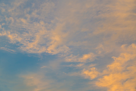 Beautiful sunset in orange and gold clouds background photo