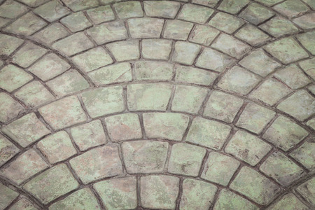Old Gray stone block paving floor background photo