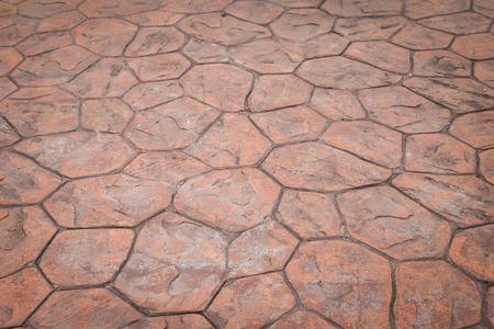 Orange concrete pavement stone texture on the floor photo
