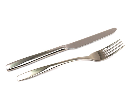 Knife and fork isolated on white background photo