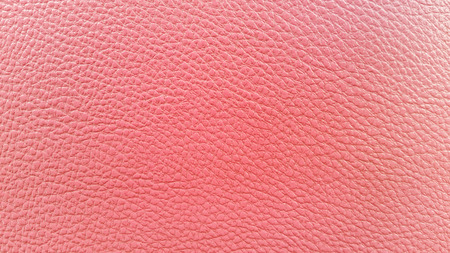 Pink leather closeup texture background photo