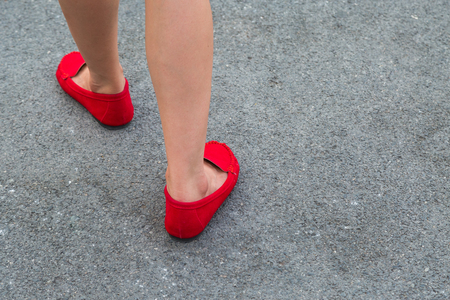 Women wearing red shoes walking on the street in the city photo