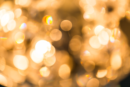 Blur Golden bokeh from beautiful crystal chandelier bokeh Stock Photo