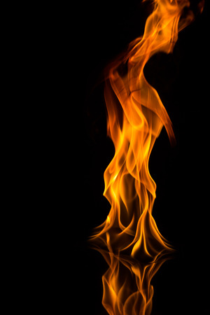 gas fireplace: fire flames with reflection on black background Stock Photo