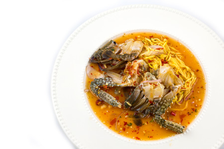 blue crab: Famous Thai food, Yum poo ma spicy mango salad with blue crab isolate on white background Stock Photo