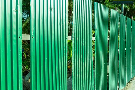 corrugation: Green fence steel sheet texture background Stock Photo