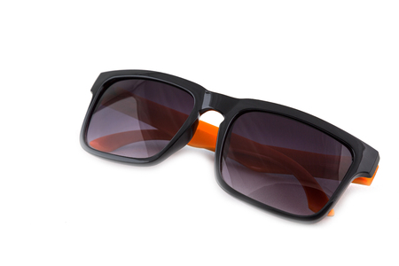 Black sunglasses with orange leg isolated on white background