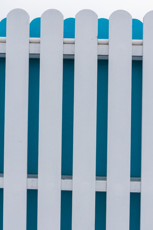 picket fence: White and blue picket fence with sky background Stock Photo