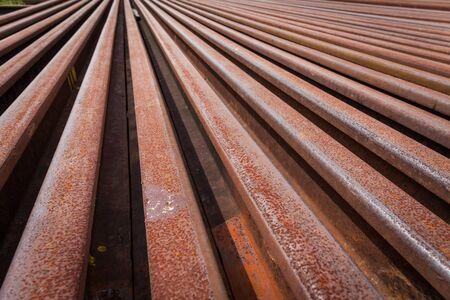 railtrack: railroad tracks with rust on rock background