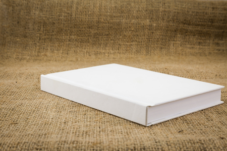 sackcloth: White book on sackcloth textured brown background
