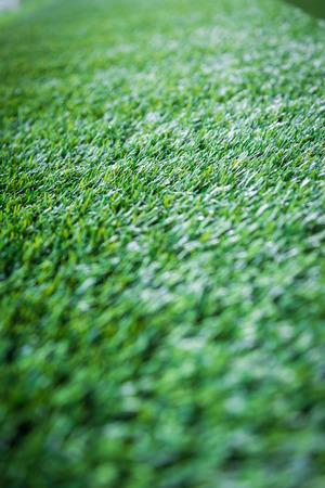 緑の芝生の人工芝パターン背景 写真素材