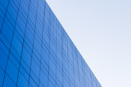 architecture abstract: Blue Glass building Modern office building background