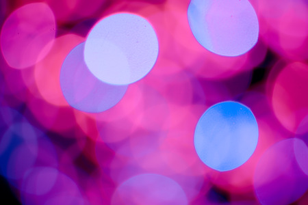 red pink: Red, pink, white, yellow and turquoise Chrismas lights bokeh background Stock Photo