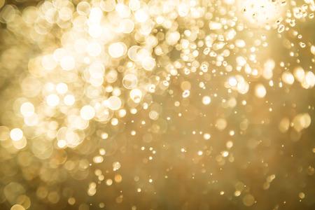 黄金の抽象的な背景のボケ味
