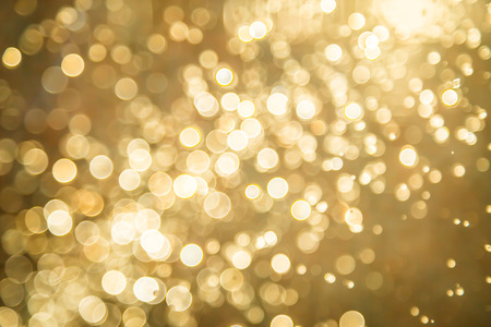 Abstract golden bokeh background