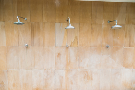shower: Outdoor shower sprinkler on brown wall background
