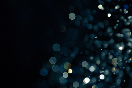 defocused: bokeh of lights on black background Stock Photo