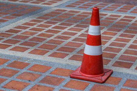 Orange traffic cone on the floor background