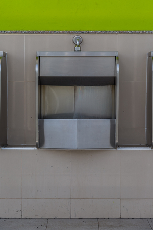 gent's: Row of stainless steel urinals in public toilets background Stock Photo