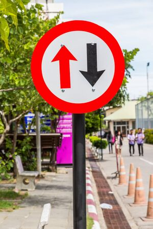 requiring: Traffic sign Warning road sign requiring driver motor to give way to oncoming traffic. Stock Photo