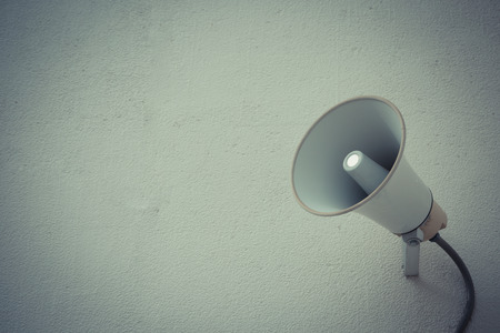 public address: Vintage style color loudspeaker setting on the wall for present News in public place Stock Photo