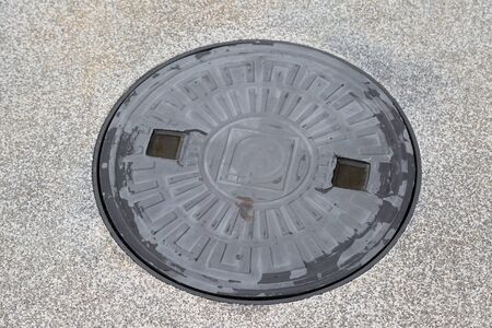 crack pipe: Metal drain cap cover on the walk way  background