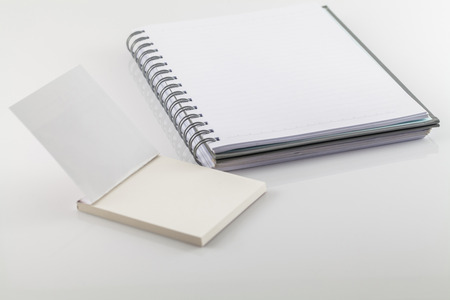 note pad: White spiral emty notebook on white background