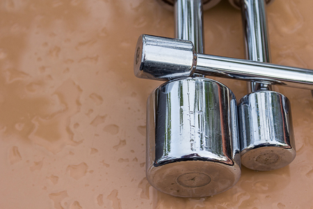 dumb bells: Glossy Steel Dumb bells set on brown table with water drop background