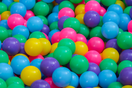 color balls: Many colorful plastic balls on childrens playground