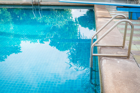 pool bars: Grab bars ladder in the blue swimming pool background