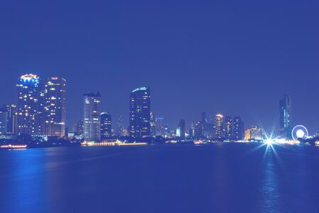 highway traffic: light of city on  the river at night background