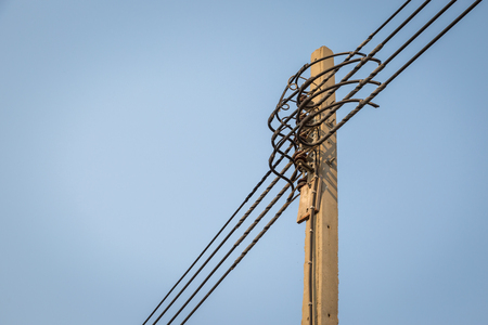 electricity pole: High voltage electricity pole with  clear sky background