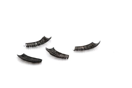 false eyelash: Old used false eyelash isolated on white background