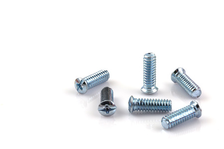 screwed: screwed screws nuts against isolated on white background