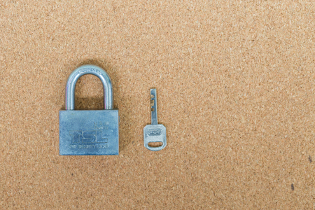 master: Old master key and key lock on cork board background Stock Photo