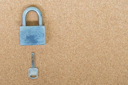 key lock: Old master key and key lock on cork board background Stock Photo