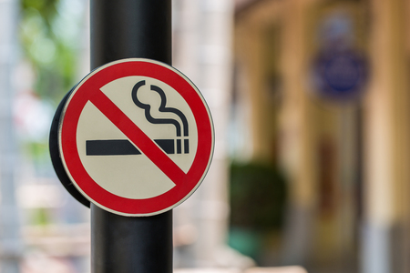 a public notice: no smoking sign with green background Stock Photo