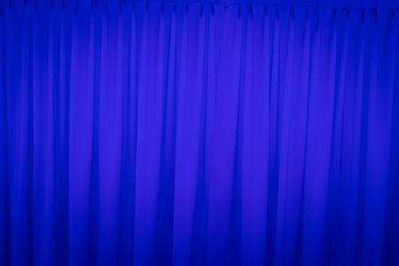 sipario chiuso: Blue closed curtain with a light spot use for background