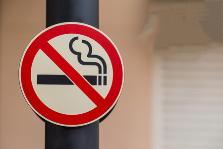 cigar shape: No smoking sign on public place background